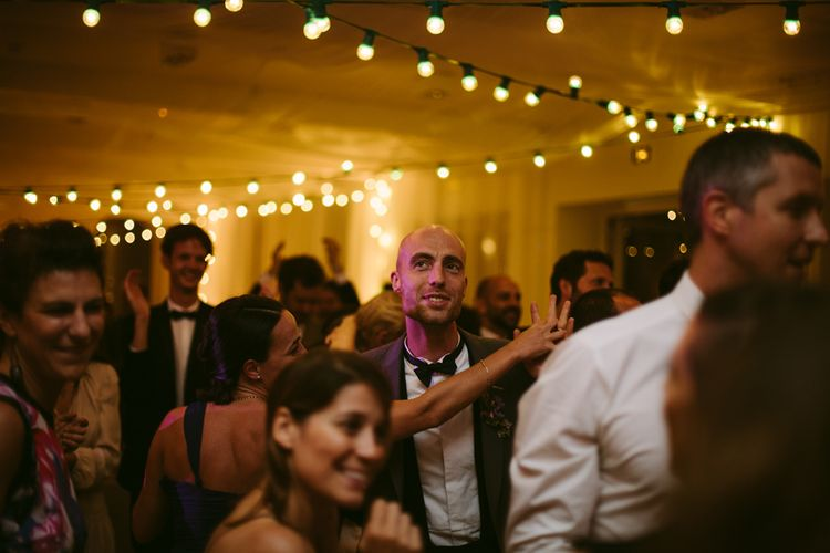 Festoon Lit Dance Floor | Stylish Two Day Wedding at Château de Varennes, Burgundy, France with I Do BBQ After Party Planned by Bulle & Tulle | Troistudios Photography | Studio80  Film