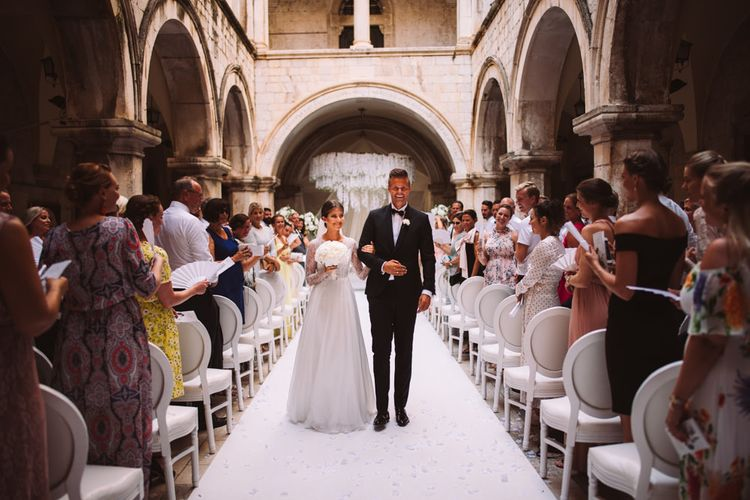 Bride and Groom Just Married Walking Down the Aisle of at 16 Century Palace in Croatia