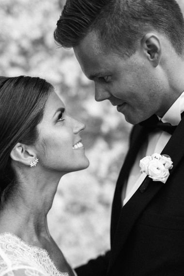 Black and White Portrait of Bride and Groom Looking into Each Others Eyes