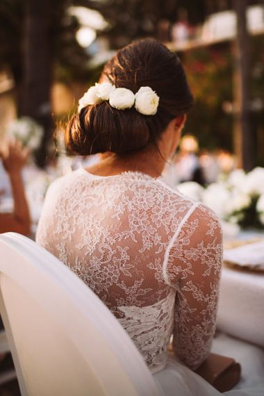Delicate Lace Back of Brides Anna Kara Bridal Gown with Chic Low Bun Hairstyle