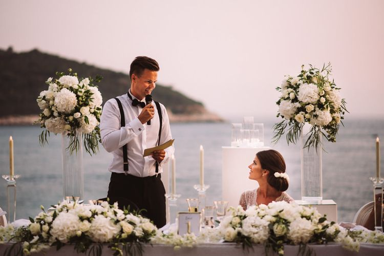 Groom Wedding Reception Speeches with White Top Table Wedding Flowers