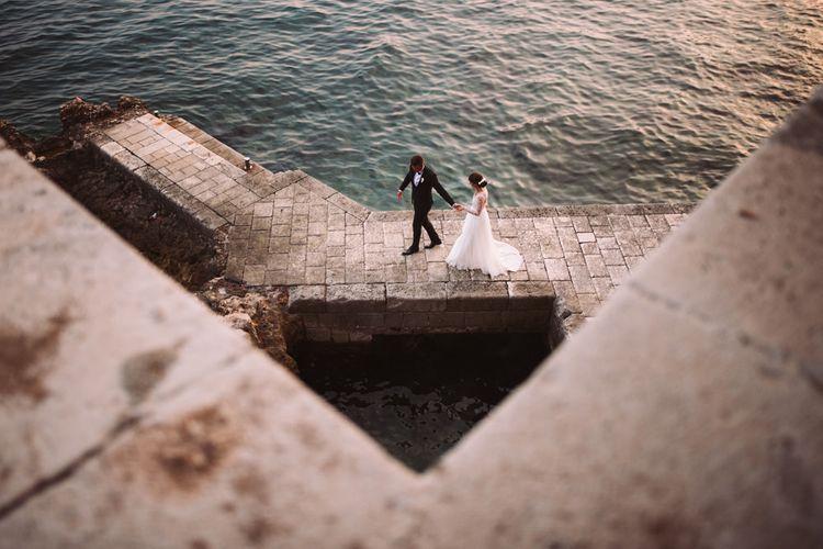 Bride and Groom Dramatic Coastal Portrait