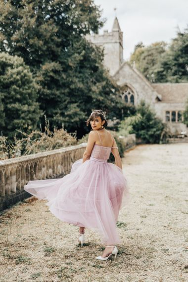 Bride Twirling in Her Coloured Tulle Emma Beaumont Wedding Dress