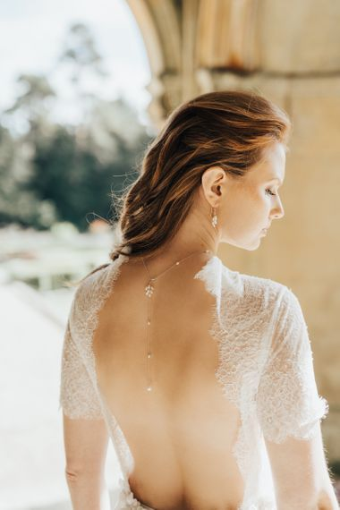Bride in Low Back Wedding Dress Wearing a Back Necklace