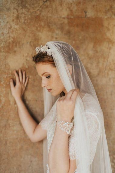 Bride Wearing an Iridescent Floral Headdress with a Wedding Veil