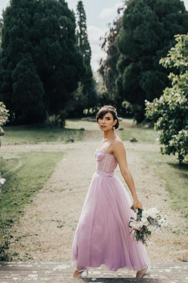 Beautiful Bride Wearing a Coloured Tulle Wedding Dress and Embellished Alice Band Hair Accessory