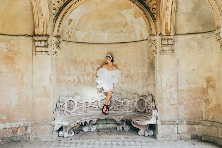 Bride in Short Puff Sleeve Wedding Dress and Red Velvet Shoes