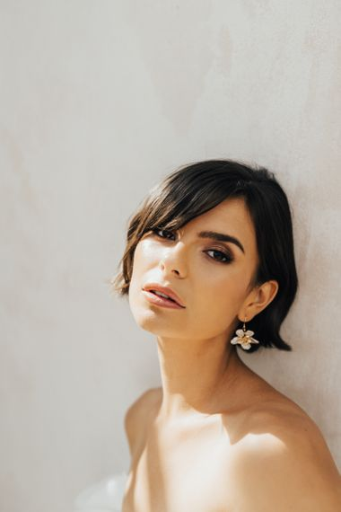 Bride with Short Bobbed Hair and Sweeping Fringe Wearing Flower Earrings