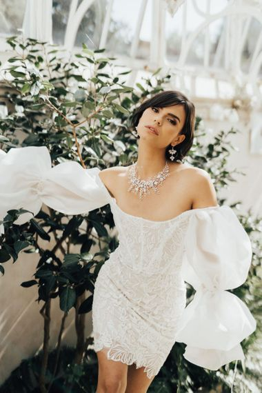 Bride in Off the Shoulder Wedding Dress Wearing an Ornate Necklace