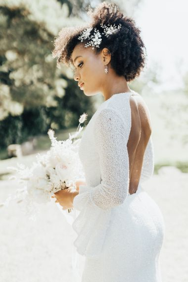 Black Bride with Afro Hair Wearing a Backless, Shimmering Emma Beaumont Wedding Dress