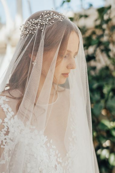 Bride Wearing a Delicate Wedding Veil with Pearl Crown Headdress on Top