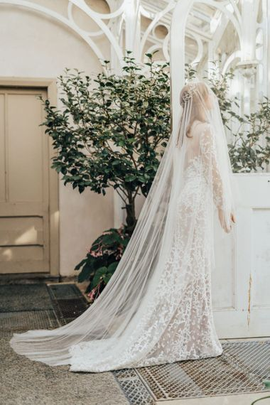 Elegant Bride in Lace Emma Beaumont Wedding Dress and Full Cathedral Length Wedding Veil