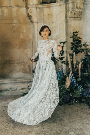 Bride in Emma Beaumont Lace Wedding Dress with Long Sleeves and Alice Band