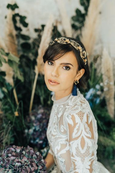 Beautiful Bride with Natural Make Up Wearing Tassel Earrings and Complementary Gold Headband