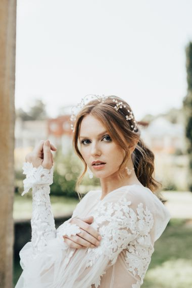 Bride with Swept Up Pony Tail Wearing a Delicate Stone Earring and Headdress Set