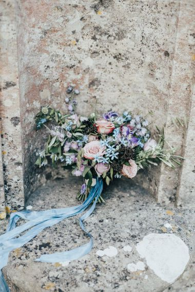Beautiful Pastel Wedding Bouquet Tied with Blue Ribbon