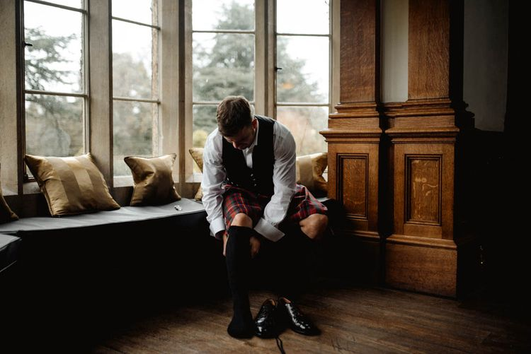 Groom Getting Ready in Tartan Kilt