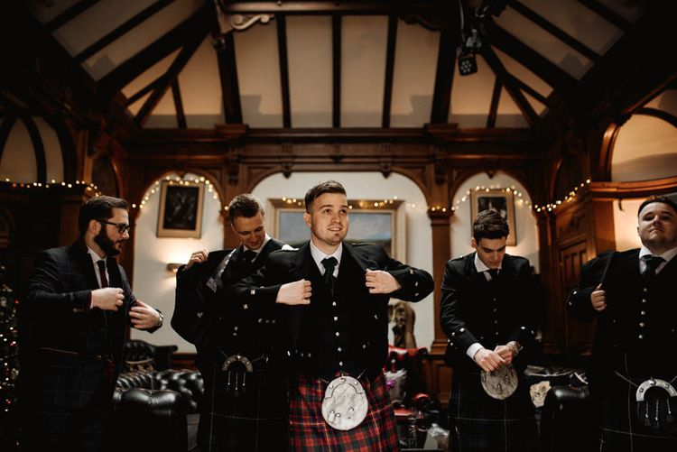 Groomsmen Getting Ready into Tartan Kilts with Sporans