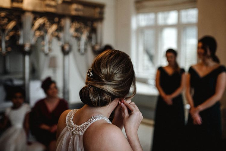 Chic Chignon Bridal Hairstyle with Diamante Comb Accessory