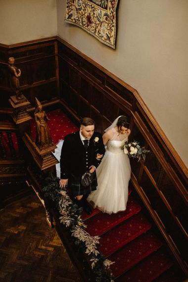 Bride Walking Down the Stairs to Wedding Ceremony