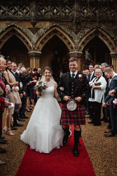 Confetti Moment with Bride in Halterneck Wedding Dress and Groom in Tartan Kilt