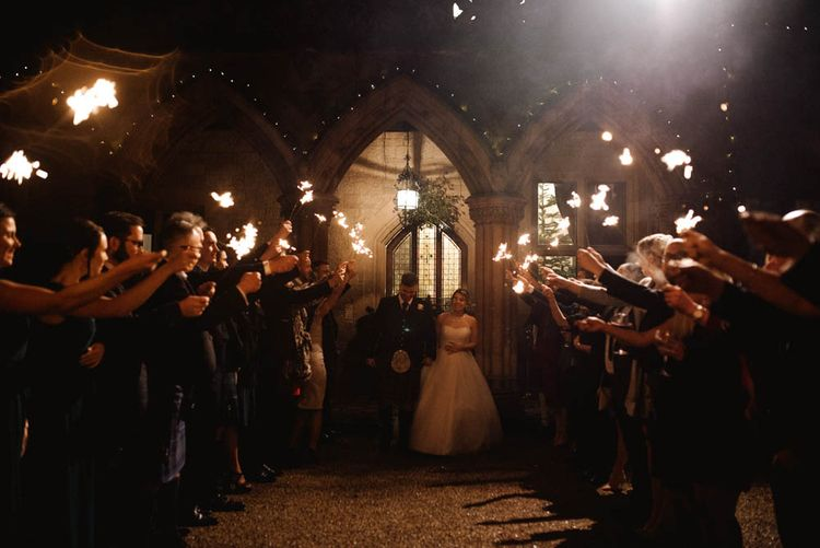 Sparkler Moment with Bride in Halterneck Wedding Dress and Groom in Tartan Kilt