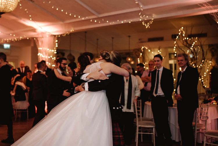 First Dance with Groom Hugging His Bride Tight and Swinging Her Around