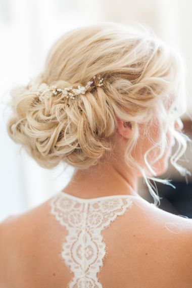 Pinned Bridal Up Do with Hair Vine