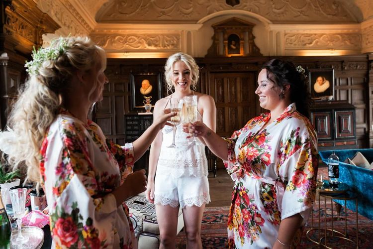 Wedding Morning Bridal Preparations with Bride and Bridesmaids Dinking Champagne
