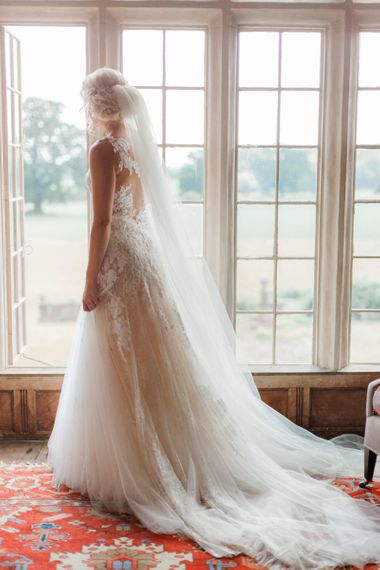 Bride in Pronovias Wedding Dress Looking Out The Window