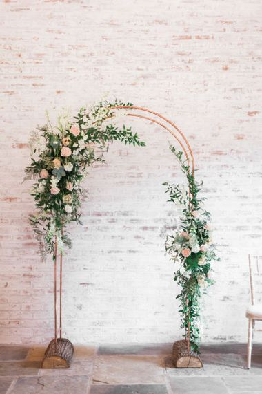 Copper Frame Arch with Pink, White and Green Floral Arrangements