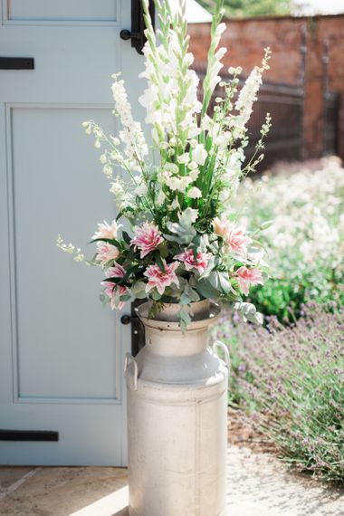 White and Pink Flower Filled Milk Churn