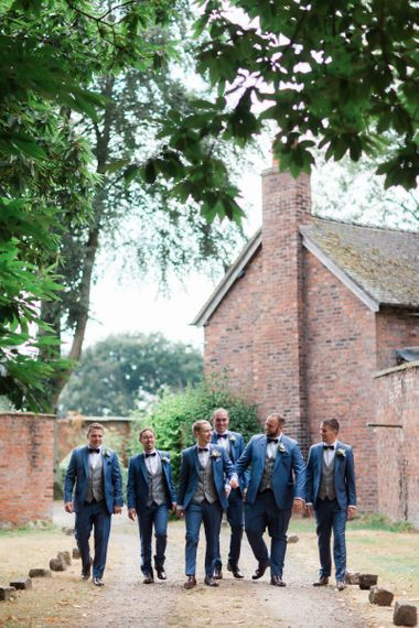 Groomsmen in Navy Suits with Grey Check Waistcoats