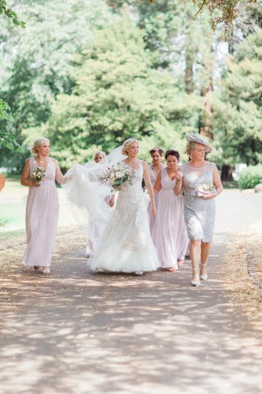 Bridal Party in Pink Maids to Measure Dresses and Bride in Pronovias Wedding Dress