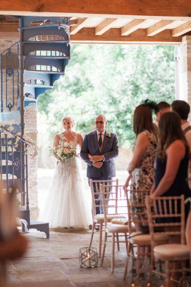 Wedding Ceremony Bridal Entrance in Lace Pronovias Wedding Dress