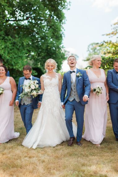 Wedding Party Portrait with Bridesmaids in Pink Dresses and Groomsmen in Navy Suits