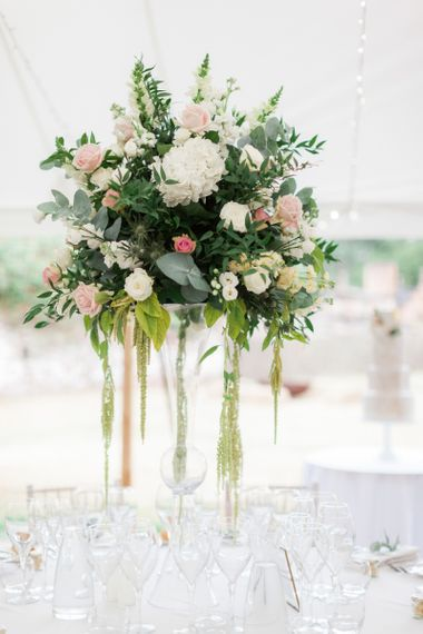 Tall Martini Glass Floral Centrepiece with Green White and Pink Flowers