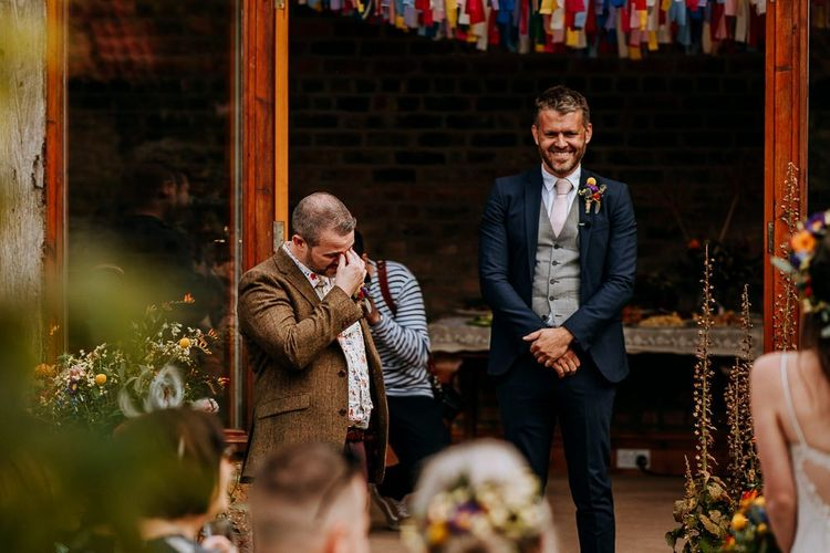 Groom in Brown Wool Jacket and Floral Shirt Getting Emotional At the Altar