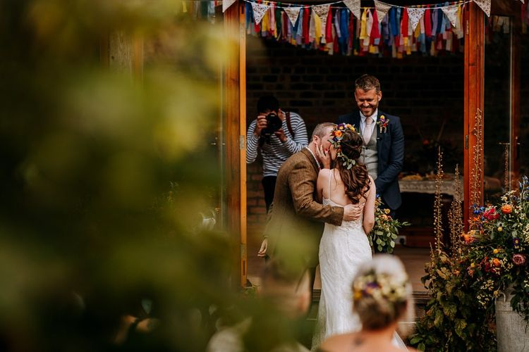 Bride Kissing Her Groom at the Altar