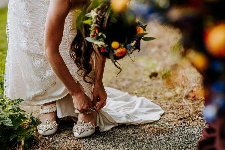 Bride in customised Wedding Shoes and  Sottero & Midgley Wedding Dress
