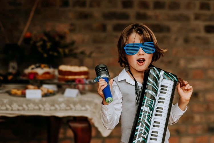 Little Wedding Guest with Inflatable Keyboard and Glasses