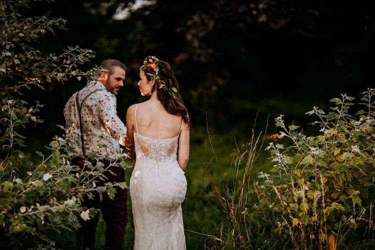Bride in Sottero & Midgley Wedding Dress and Colourful Flower Crown and Groom in Floral Shirt