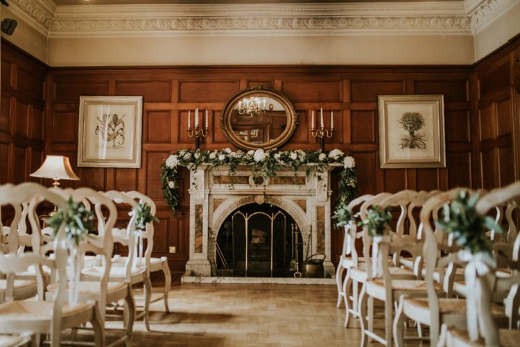 Aisle & Altar Style | Greenery & White Fireplace Mantle Wedding Flowers | Green, White & Gold Wedding at Buckland Tout Saints, Devon |  Darina Stoda Photography