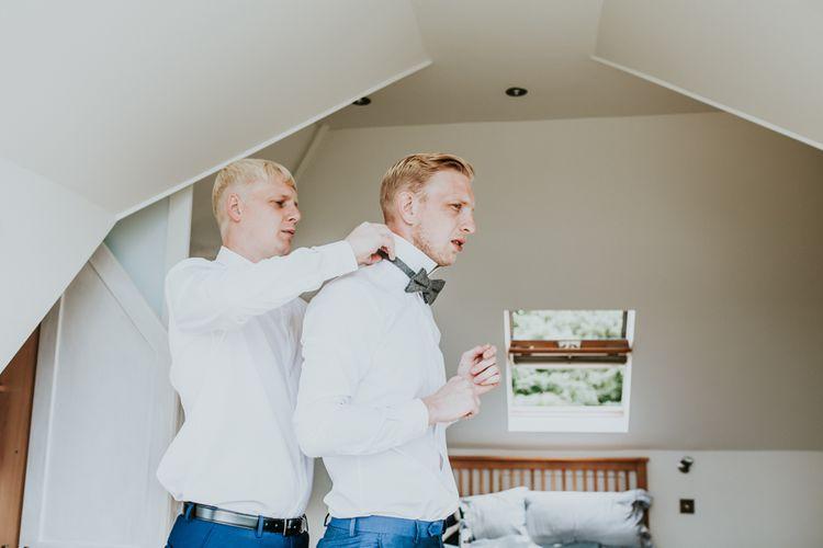 Grooms Morning Wedding Preparations | Green, White & Gold Wedding at Buckland Tout Saints, Devon |  Darina Stoda Photography