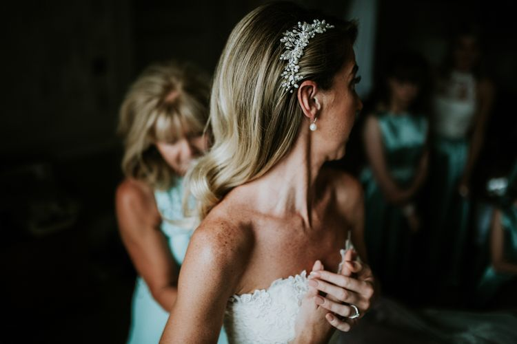 Bridal Morning Preparations | Bride in Pronovias Oringo Lace Bridal Gown & Debenhams Hair Accessory | Green, White & Gold Wedding at Buckland Tout Saints, Devon |  Darina Stoda Photography