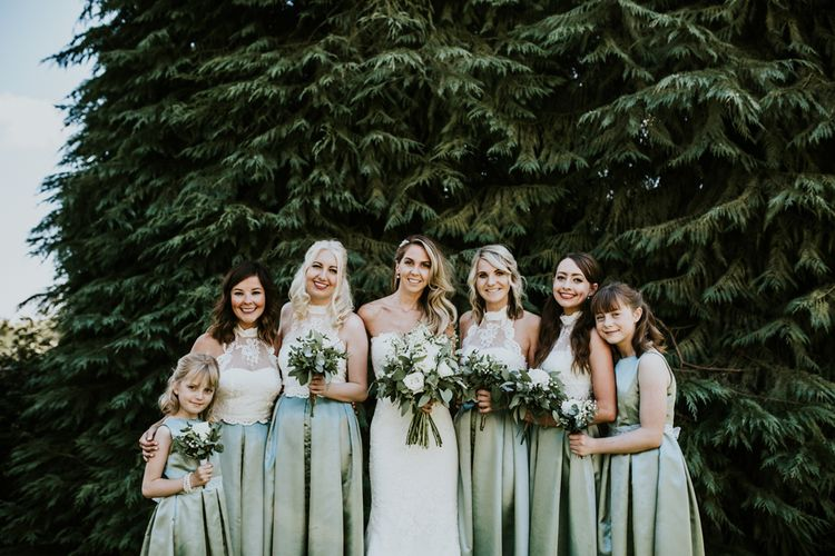 Bridal Party | Bridesmaids in Mint Green Homemade Skirts & ASOS Tops | Bride in Pronovias Oringo Lace Bridal Gown & Cape | Green, White & Gold Wedding at Buckland Tout Saints, Devon |  Darina Stoda Photography