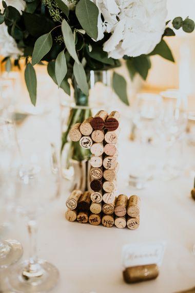 Cork Table Number Wedding Decor | Green, White & Gold Wedding at Buckland Tout Saints, Devon |  Darina Stoda Photography