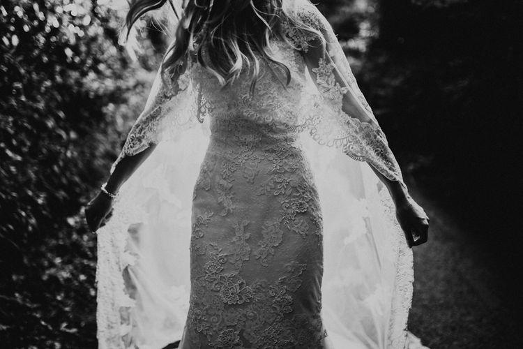 Bride in Pronovias Oringo Lace Bridal Gown & Cape | Green, White & Gold Wedding at Buckland Tout Saints, Devon |  Darina Stoda Photography