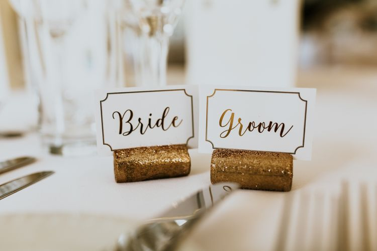 Bride & Groom Place Names in Glitter Corks | Green, White & Gold Wedding at Buckland Tout Saints, Devon |  Darina Stoda Photography