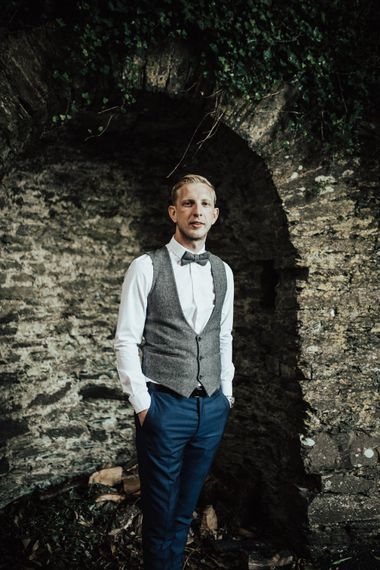 Groom in Tweed Waistcoat & Blue Marks and Spencer Suit | Green, White & Gold Wedding at Buckland Tout Saints, Devon |  Darina Stoda Photography